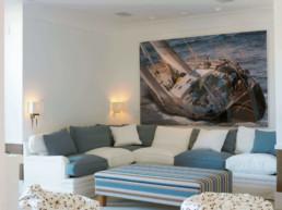 Imagen de sala de estar en tonos azules. Decoración a cargo del estudio de arquitectura e interiorismo Cristina Arechabala.