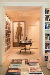 Imagen de biblioteca-sala de estar en vivienda particular. Decoración y diseño de interiores por estudio de arquitectura e interiorismo Cristina Arechabala.